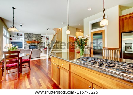 Wood luxury large kitchen with island, red and granite.
