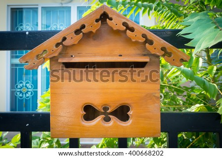 Wood mailbox on home page - stock photo
