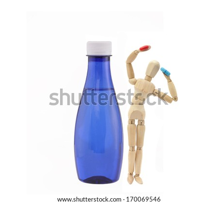 Wood Manikin Holding Prescription Drug Pills Red Blue Arms Raised up in Air Next to Blue Bottled Filtered Water isolated on white background