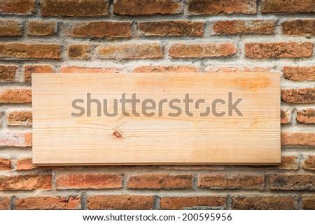 Wood on stone wall - stock photo