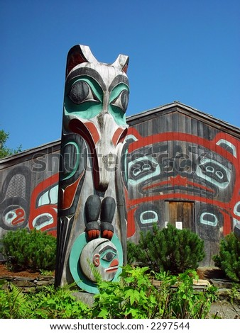 Wood painted Alaskan Totem Pole on Saxman Native Village, Ketchikan, Alaska. - stock photo