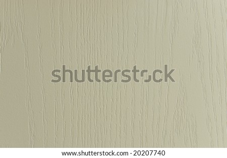 Wood panel on the exterior of a house painted off-white.