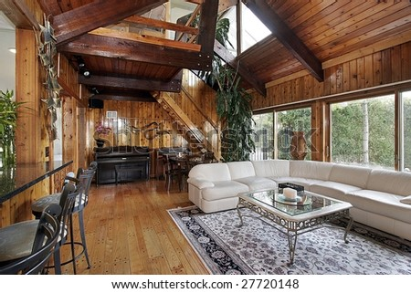 Wood paneled family room - stock photo