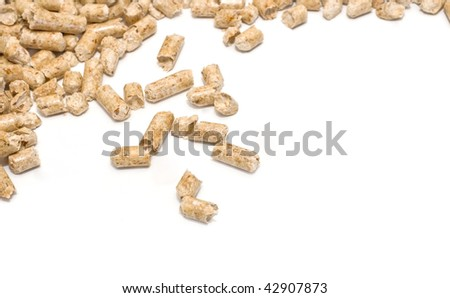 Wood pellet fuel on a white background - stock photo