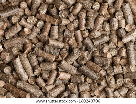 Wood pellets forming a background pattern - stock photo