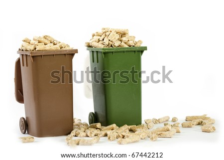 wood pellets in recycle bin - stock photo