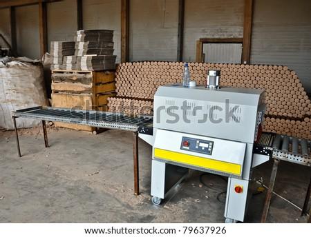 Wood pellets machine shop - stock photo