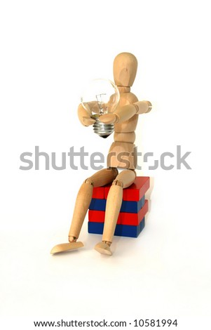 wood person with lamp in his hands - symbol of idea - stock photo