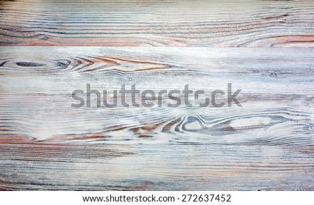 Wood plank soft red grey texture background. Image of natural wooden texture of Alaskan birch with vivid orange red grey colors. High contrast and unusual colors - stock photo