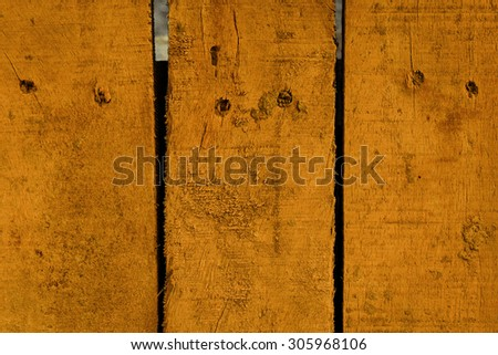 wood plank with orange color painted background