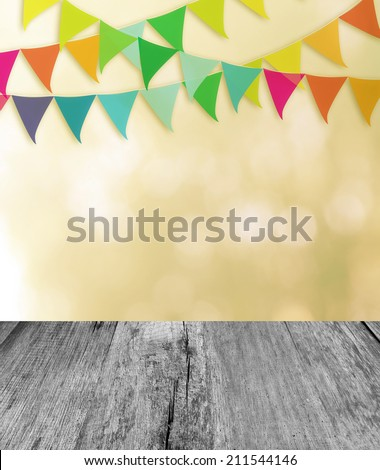 Wood planks floor with festival flag background. - stock photo