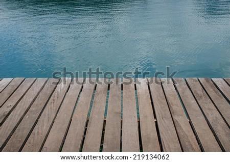 wood platform beside bay - stock photo