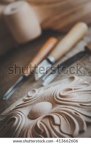 Wood processing. Joinery work. wood carving.  Carpenter wood chisel tool with carving . small depth of field. vintage toning effect. use as background - stock photo