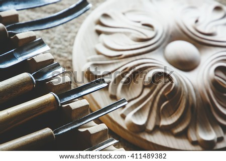 Wood processing. Joinery work. wood carving. chisels for carving close up. small depth of field. use as background - stock photo