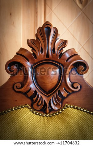 Wood processing. Joinery work. wood carving. Detail of a Classical chair with hardwood used as background.  - stock photo