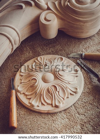 Wood processing. Joinery work. wood carving  with work tools close up. small depth of field. use as background - stock photo
