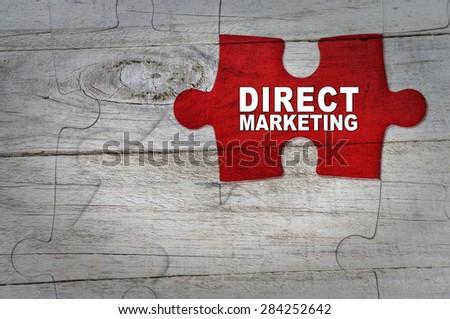 Wood Puzzle: Direct marketing - stock photo