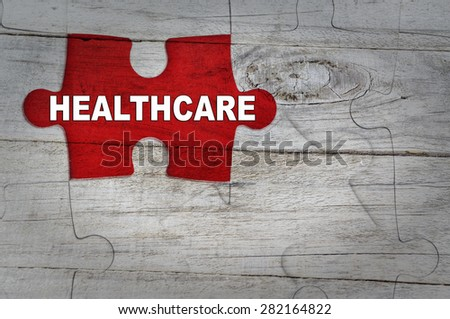 Wood Puzzle: Healthcare Concept - stock photo