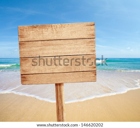 wood road sign on sea beach - stock photo