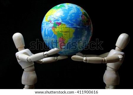 wood robot hold mini  world in earth day