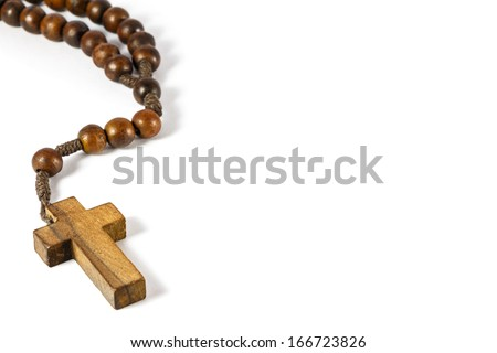 wood rosary with cross at left border and blank area at right side (white background) - stock photo