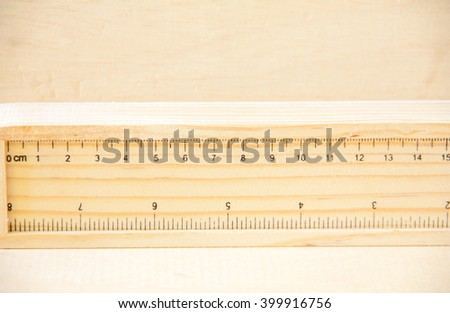 Wood ruler on wood wall - stock photo