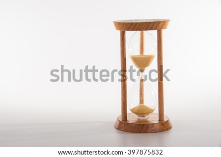 wood sandglass on white background