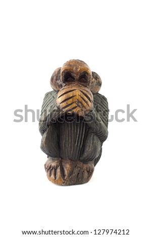 wood sculpture of speak no evil monkey on white background - stock photo