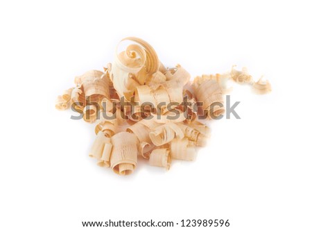 Wood shavings, beautifully curled in to a spiral isolated on white - stock photo