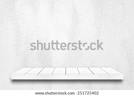 Wood shelf on white cement wall background - stock photo