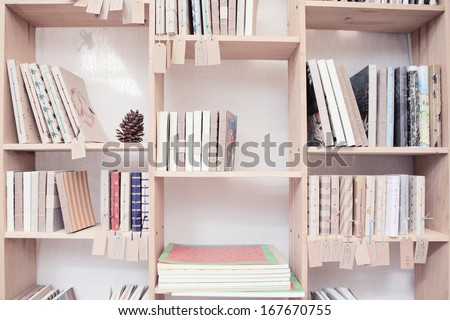 wood shelf with book