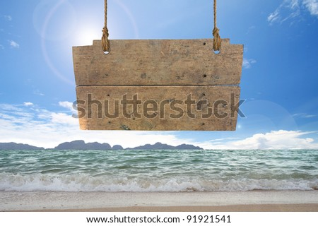 wood sign hanging on beach - stock photo