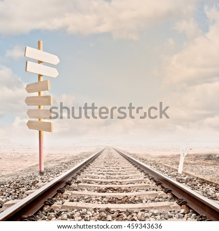 wood sign on a railway track