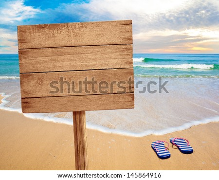 wood sign on beach - stock photo