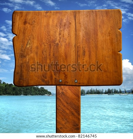 wood sign with ocean background