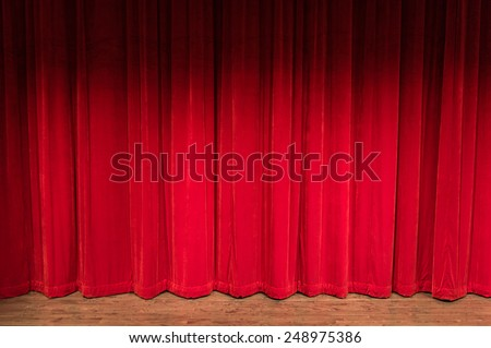 wood stage with closed red curtains with shadow at the top - stock photo