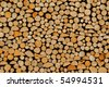 Wood stock background ? stacked firewood pattern - stock photo