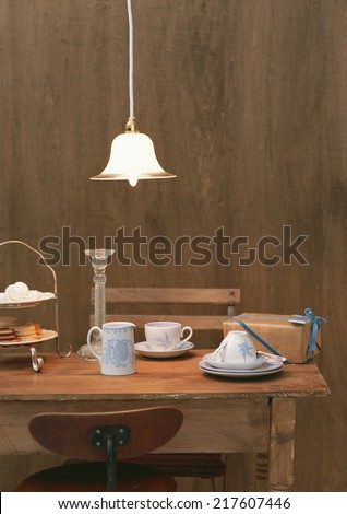 wood table and chairs - stock photo
