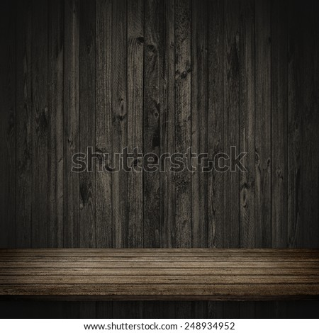 Wood table and dark wood wall background - stock photo