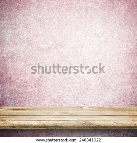Wood table and white an pink concrete wall background - stock photo