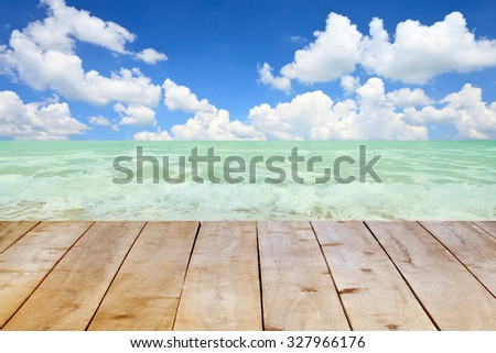 Wood table on blurred beach background. - stock photo