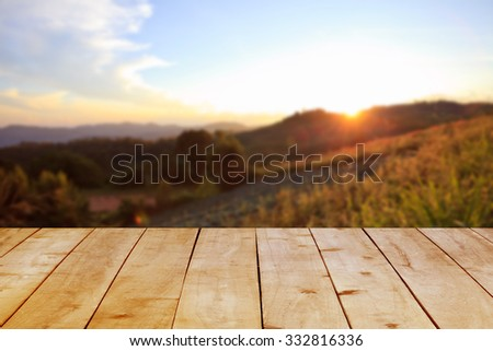 Wood table on forest and sunset. - stock photo