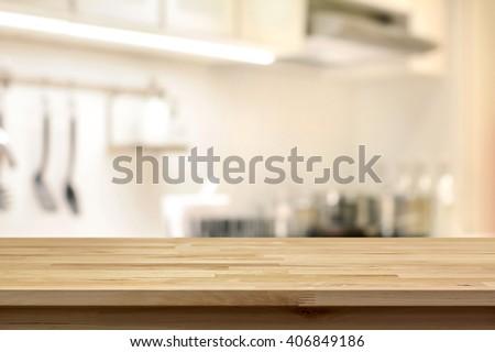 Wood table top (as kitchen island) on blur kitchen background - can be used for display or montage your products - stock photo