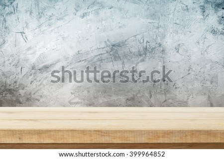 Wood table top on bare concrete wall background, vintage, background, template, display