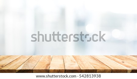 Wood Table Top On Blur Glass Window Wall Building Background.For Montage  Product Display Or