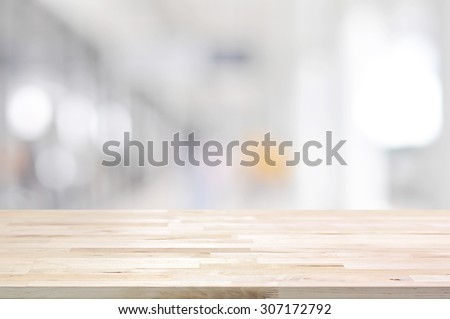 Wood table top on blurred white gray background from hallway - can be used for display or montage your products - stock photo