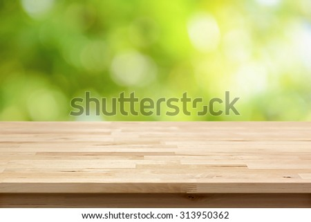 Wood table top on bokeh abstract green background  - can be used for montage or display your products - stock photo