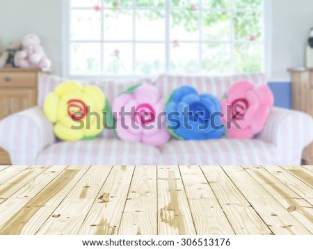 Wood table top on interior living room blurred background - stock photo
