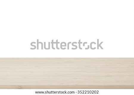 Wood table top texture in light natural sepia brown color tone isolated on white background: Wooden tabletop textured pattern backdrop in tan toned colour for interior/ product display    - stock photo