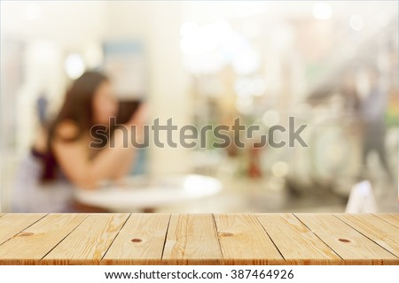 Wood table top with blurred  office as background - can be used for montage or display your products - stock photo